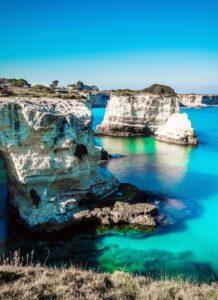 idyllic-shot-of-rock-formation-in-sea-at-salento-against-sky-611458547-5bdb6e3cc9e77c0026d4409b